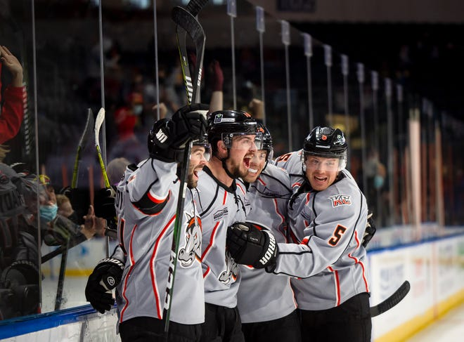 Kansas City Mavericks forward Darik Angeli, second from left, is mobbed by teammates after scoring what proved to be the winning goal with just 56 seconds left in Monday afternoon's game against the Allen Americans. Angeli's goal gave the Mavericks a 3-2 lead and Brodie Reid added an empty-net goal 23 seconds later for a 4-2 win to knock Allen out of first place in the ECHL's Western Conference.