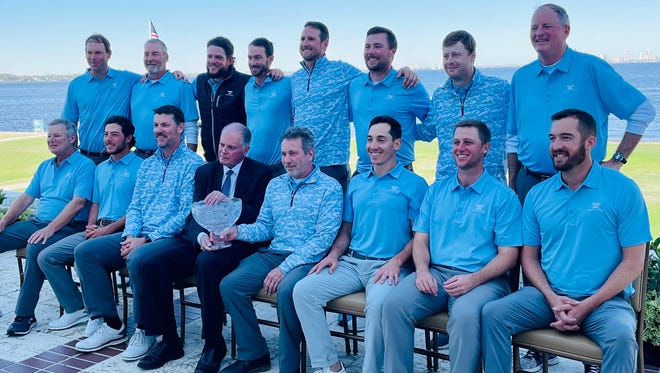 The Amateur team displays the Underwood Cup it won for the fifth time in a row on Tuesday at the Timuquana Country Club. In the front center, holding the Cup, is amateur captain Andy Purnell and Clayton Bromberg of Underwood  Jewelers.