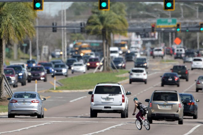 A bicyclist cuts across Beach Boulevard near Grove Park Boulevard. The Jacksonville Sheriff's Office has received a $57,000 contract from the University of North Florida in partnership with the Florida Department of Transportation to fund overtime traffic deployments focused on improving bicyclist and pedestrian safety beginning this week.