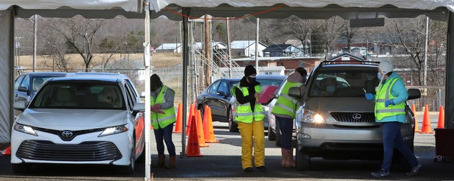 Cars line up with people waiting for their COVID-19 vaccination as the Cleveland County Health Department used the fairgrounds for vaccinations Tuesday.