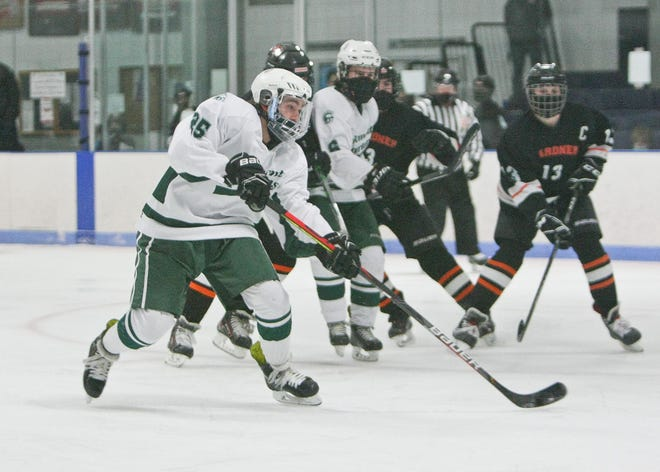 Oakmont's Kaleb Jakola (25) fires a shot on goal during the Spartans' 5-2 win over the Gardner/Murdock Wildcats, Monday afternoon, at Veterans Arena in Gardner. Jakola recorded a hat trick in the Spartans victory.