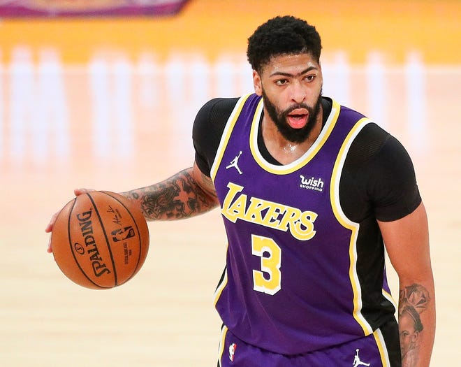 Anthony Davis of the Los Angeles Lakers looks to pass the ball in the game against the Memphis Grizzlies at Staples Center on Feb. 12, 2021 in Los Angeles, Ca. Davis will be sidelined, possibly through the All-Star break, as the team waits for his lower right leg to heal.