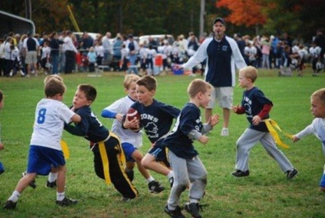 Alex Ford, second from left, with eyes closed, is seen during a flag football game.