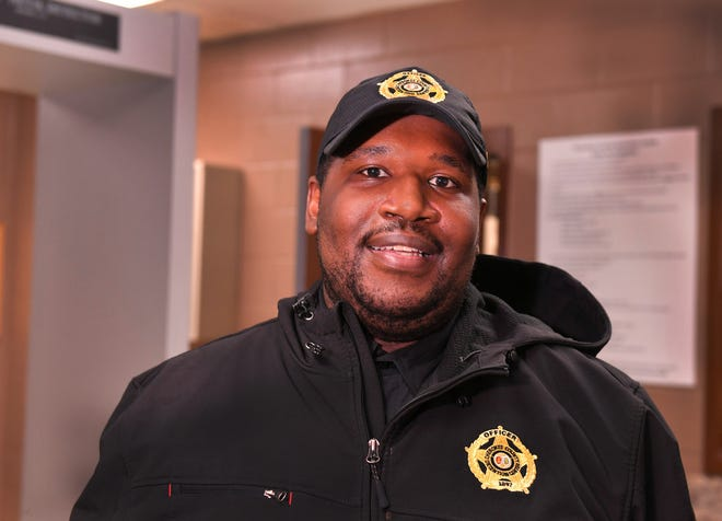 Georgio Foster is a detention officer at the Cherokee County Jail, Friday, February 12, 2021. He tested positive for COVID-19 in August and almost died. He survived his ordeal and returned home in October. Foster is back at work and has fully recovered.