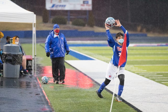 West Henderson coach Brian Brewer stands in a large puddle of water on the sidelines during Monday's match against North Buncombe at West. [PAT SHRADER/ BLUERIDGEEXPRESSIONS.COM]
