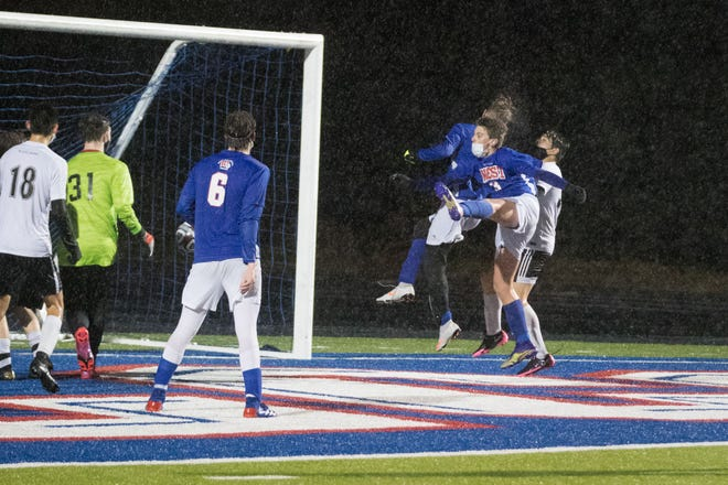 Nick Pickard (3) scores for West Henderson off a corner kick, with an assist from Woody Greene. [PAT SHRADER/ BLUERIDGEEXPRESSIONS.COM]