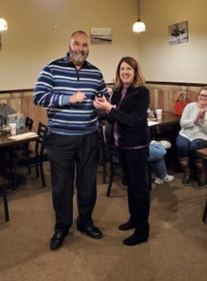"""At a recent meeting of the Richlands Rotary Club, Tony Bostic was awarded the """"Paul Harrison Award"""" by club president Melissa Kepes."""