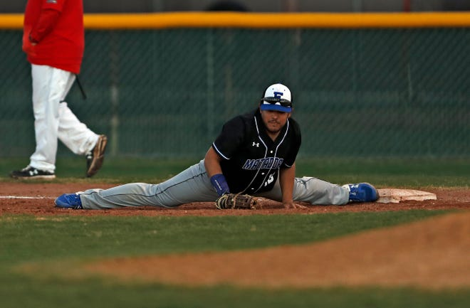 Estacado's Frank Guzman (18) stretches while trying to tag out the baserunner during a game March 14, 2020 against Coronado as part of the First Pitch Classic at O'Banion Field. [Brad Tollefson/A-J Media]