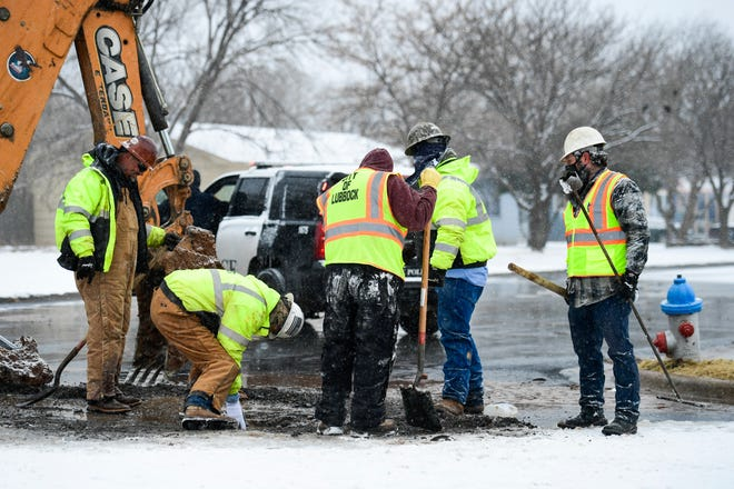 City workers work to stop a water leak after a fire hydrant was hit at 42nd Street and Avenue U on Tuesday, Feb. 16, 2021, in Lubbock, Texas. [Justin Rex/For A-J Media]