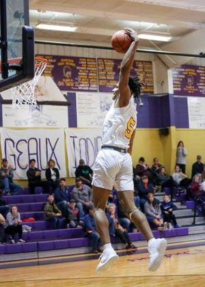 Anacoco senior Shaun Riley soars in for the dunk during the Indians' win over Negreet on Saturday.