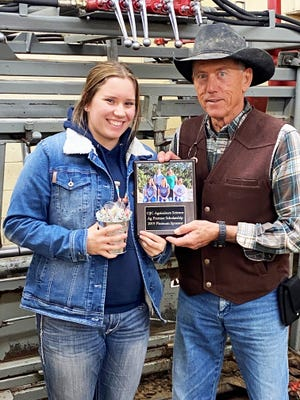 Colorado Vet Clinic is a Platinum sponsor for OJC Ag scholarships. From left, OJC scholarship recipient Ali Bregar and Colorado Vet Clinic co-owner Zane Leininger.
