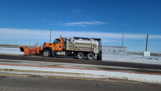 A truck plows ice along the westbound lane of US 50 in La Junta.  The La Junta area breached negative temperatures on Saturday and is not expected to resurface into above-freezing temps until Friday.