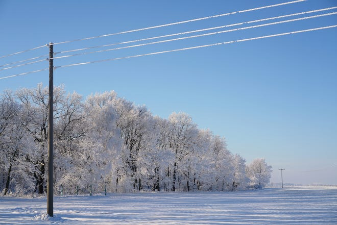 Power lines in the snow.