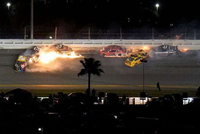Racers crash during the last lap in the NASCAR Daytona 500 auto race at Daytona International Speedway, Monday, Feb. 15, 2021, in Daytona Beach, Fla. Joey Logano (22) was leading before the wreck; Brad Keselowski (2) was in second.