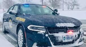 A snowy Missouri State Highway Patrol vehicle.