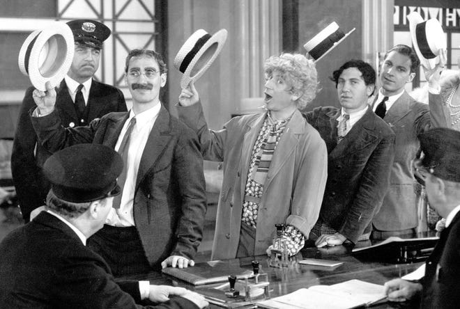 "The Marx Brothers: Groucho, Harpo, Chico, and Zeppo in ""Monkey Business."""
