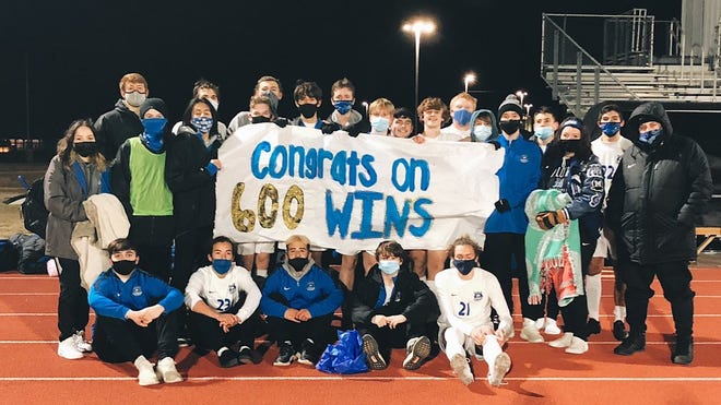 The Midlothian Panthers gather to celebrate the 600th career coaching victory for head soccer coach Austin Guest last Tuesday in a 4-0 win at Cleburne. Guest later made it 601 as he coached the Lady Panthers to a 3-0 whitewash of the Lady Jackets.