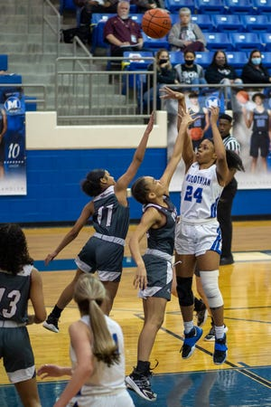 Midlothian senior and Tulane signee Kierra Middleton (24) shoots a jumper in the lane during a district game against Ennis. The Lady Panthers' season came to an abrupt end on Friday night in a double-overtime loss to Royse City.