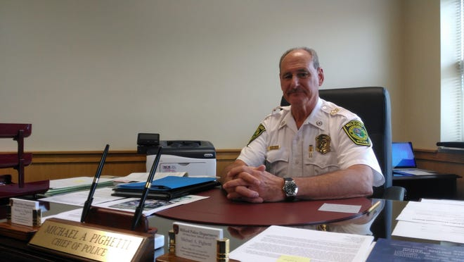 Milford Police Chief Michael Pighetti is defending himself after selectmen placed him on paid administrative leave.