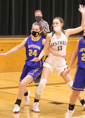 St. Mary Catholic Central's Isabelle Alston (13) posts up Kirsten Vanisacker of Jefferson Monday night. Alston scored a career-high 27 points to lead her team to a 53-26 victory. [Photo courtesy of AMANDA MILLER]