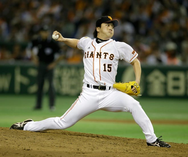 Former Yomiuri Giants pitcher Hirokazu Sawamura, shown delivering a pitch during Game 4 of baseball's Japan Series at Tokyo Dome in Tokyo on Oct. 30, 2013, has signed with the Red Sox .