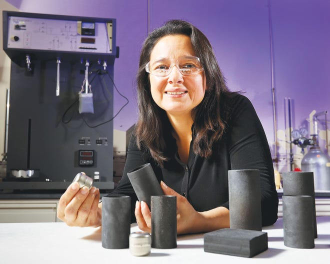 ORNL's Nidia Gallego holds a sleeve of carbon-bonded carbon fiber insulation, which provides a layer of protection for the NASA Rover's heat iridium-clad plutonium fuel. The low-density thermal insulator sleeve and discs balance iridium's properties to help maintain the temperature of the power system, but it is light enough that it adds negligible weight. At the on-site DOE user facility for carbon fiber innovation, ORNL continues to refine the mechanical properties of carbon fiber material for a range of applications, focusing on structure property and improving processes.