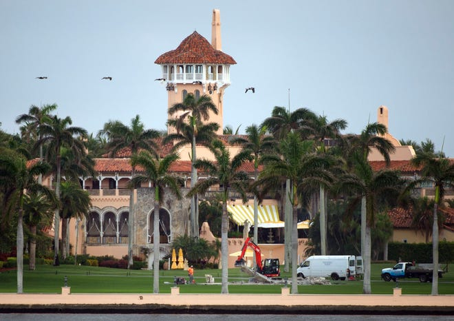 Crews demolish the helipad a Mar-a-Lago Club on Tuesday. The pad was installed after Trump became president under the condition it be removed when he left office.