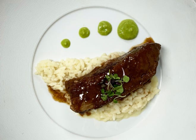 Braised beef short ribs at Trevini are served with Parmesan risotto.