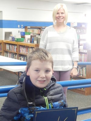 Keigan White was presented with his certificate by nominating teacher, Mrs. Mary Janssen.