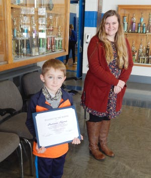 Hudson Lyons was presented with his certificate by his nominating teacher, Mrs. Abbey Kendall.