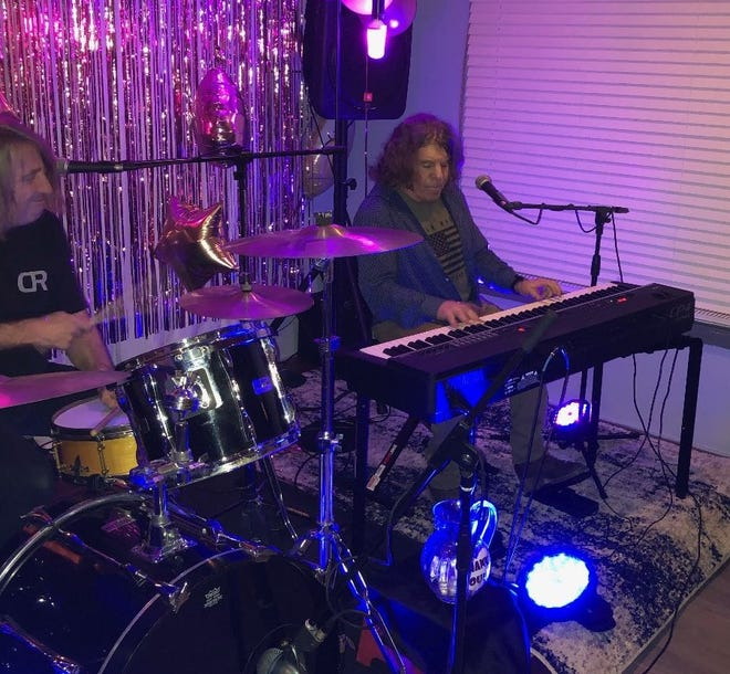 Well known musicians Michael Troy (right) and Matt Luneau (left) perform in the new music room at Bogie's