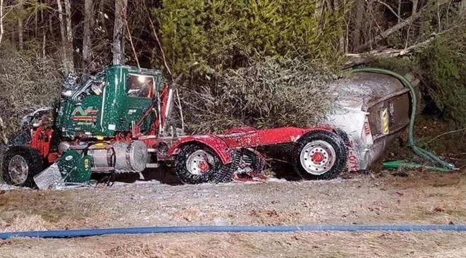 A 2018 Mack truck came to a stop off Route 101 in Epping Dec. 16, 2019, after being struck by a car, causing a fuel spill of more than 5,000 gallons from a tanker towed by the truck, according to police. [N.H. State Police photo, file]