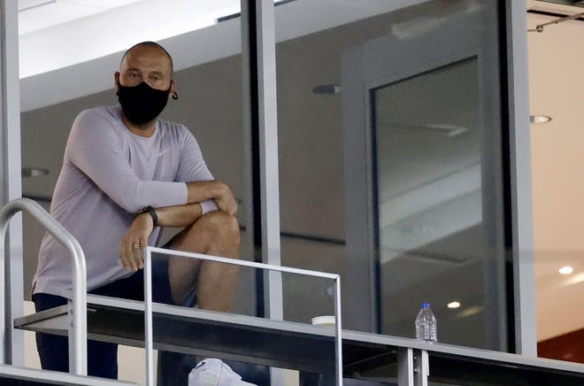 Miami Marlins chief executive officer Derek Jeter watches a game between the Marlins and Washington Nationals from his suite at Marlins Park last season. [Rhona Wise-USA TODAY Sports]