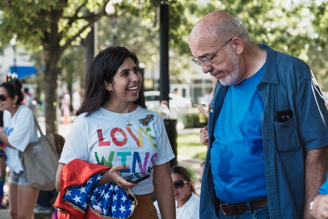 Florida State Rep. Anna Eskamani (D-Orlando) speaks with a supporter prior to the pandemic.
