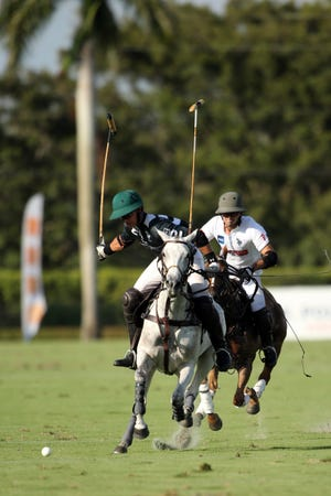 Jeff Hall (left) of La Indiana and Costi Caset of Daily Racing Form compete in last Sunday's USPA Gold Cup at International Polo Club Palm Beach.