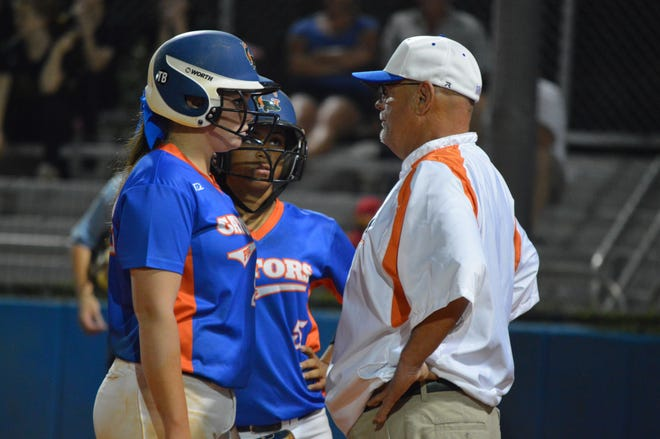 In this 2016 photo, Palm Beach Gardens softball coach Randy Jackson, right, talks with his players. After the coronavirus pandemic halted the spring season last year, Jackson is excited for the 2021 campaign.