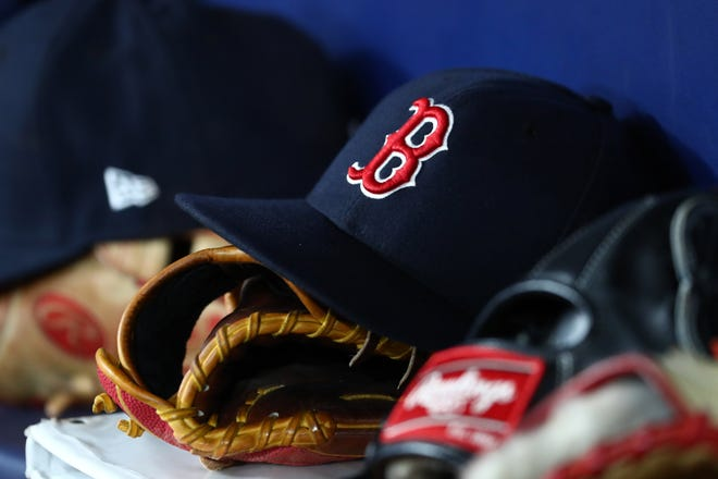 Sep 20, 2019; St. Petersburg, FL, USA; A detail view of Boston Red Sox hats and gloves at Tropicana Field. Mandatory Credit: Kim Klement-USA TODAY Sports