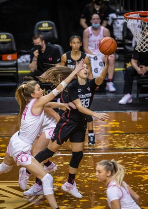Stanford's Hannah Jump (33) goes to the basket against Oregon's Lydia Giomi during Monday's game at Matthew Knight Arena.