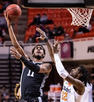 Kansas State forward Antonio Gordon (11) shoots the ball over Oklahoma State's Kalib Boone (22) during last Saturday's game in Stillwater, Okla.