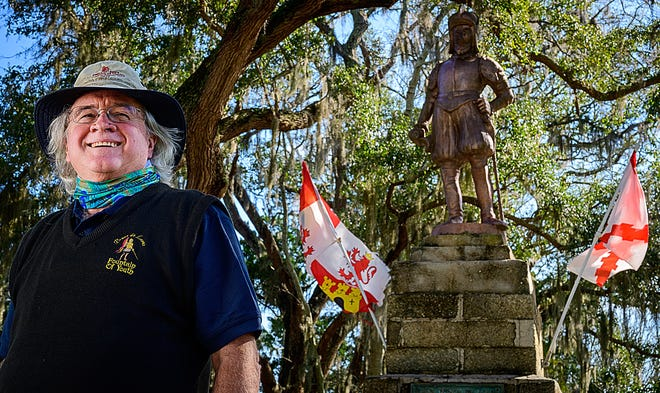Historical re-enactor Brian Bowman stands in front of a statue of Spanish conquistador Juan Ponce de León on the grounds of the Fountain of Youth Archaeological Park in St. Augustine on Tuesday. Bowman is this year's recipient of the City of St. Augustine's de Aviles Award.
