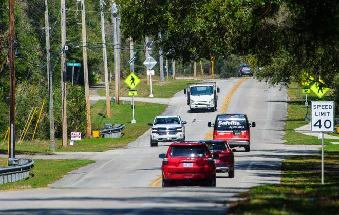 Vehicles travel down Wildwood Drive in St. Augustine on Tuesday.