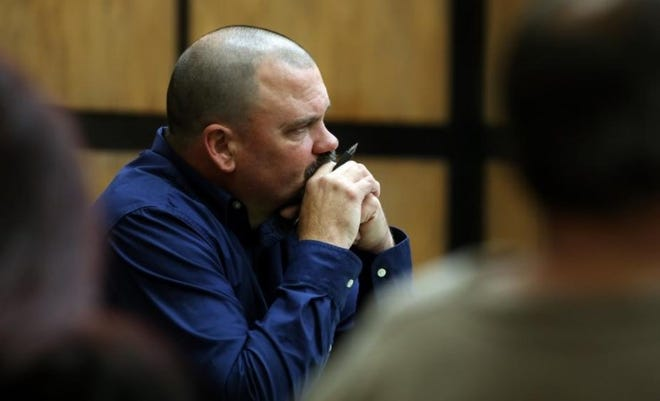 Chad Bridges sits at the defense table during his 2018 trial.