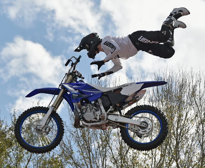 Mike Ouellet shows off some stunts at last year's Thunder By The Bay. The music and motorcycle festival returns to Sarasota Fairgrounds Friday through Sunday.