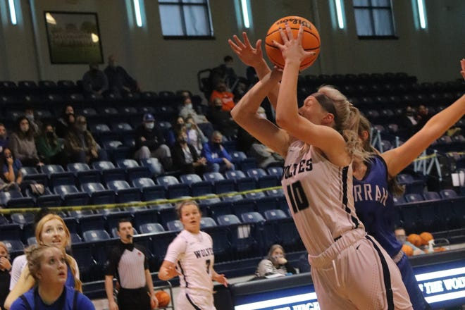 Shawnee senior Aubrie Megehee (10) puts up a shot during a recent home game against Harrah.