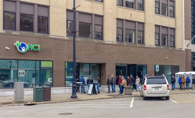 Customers wait in line Jan. 2, 2020, outside of HCI Alternatives in Springfield to purchase marijuana for recreational use. The Illinois Department of Revenue reported that the first month of legalized adult-use cannabis sales in Illinois generated $7.3 million in cannabis state tax revenue.