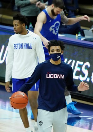 UConn guard James Bouknight, front, watches his teammates warm up at Harry A. Gampel Pavilion in Storrs.