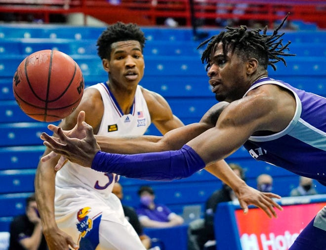 Kansas State guard Selton Miguel, right, loses control of the ball as Kansas guard Ochai Agbaji defends during a Feb. 2 matchup at Allen Fieldhouse in Lawrence. The Jayhawks won that contest 74-51 and enter Wednesday's rematch with the Wildcats as winners of four out of their last five games.