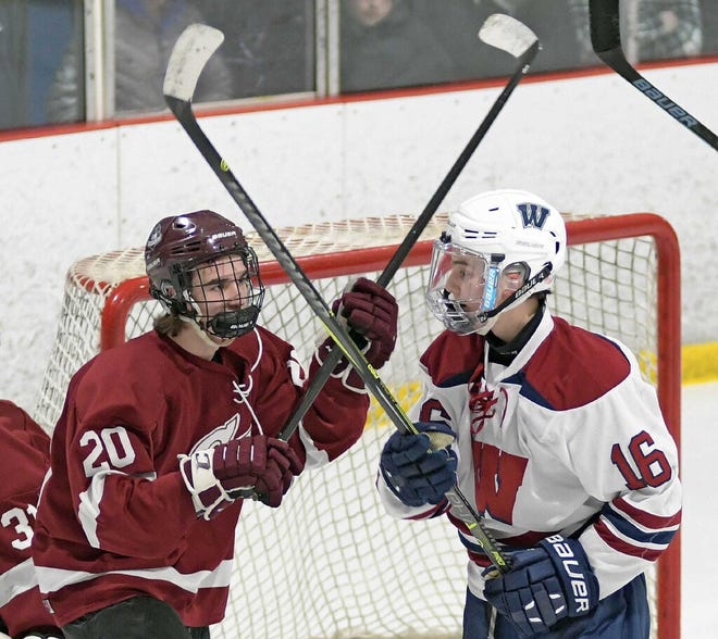 Groton-Dunstable senior forward Nate Glencross, left, just collected his 100th career point.