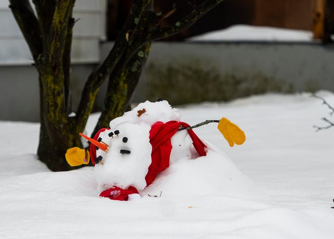 LEOMINSTER - A snowman was no match for climbing temperatures Tuesday afternoon.