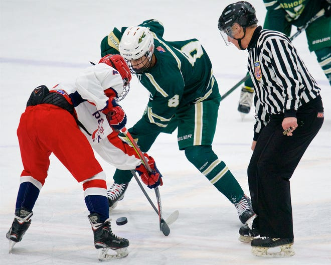 Jimmy O'Keefe, left, takes a faceoff for North Middlesex last season.